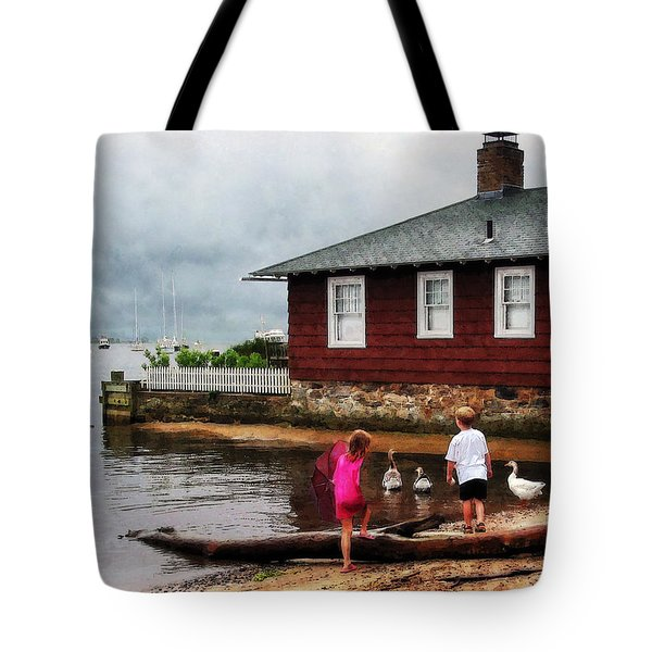 Tote Bag featuring the photograph Children Playing At Harbor Essex Ct by Susan Savad