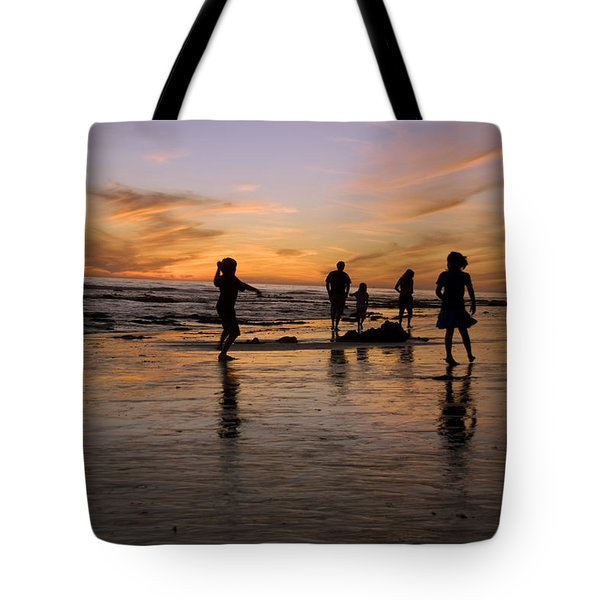 Children Playing On The Beach At Sunset Tote Bag by James Forte