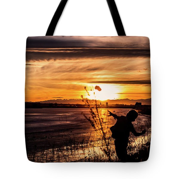 Tote Bag featuring the photograph Childs Play by Tyson Kinnison