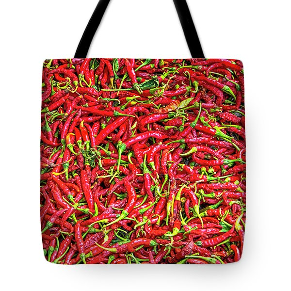 Tote Bag featuring the photograph Chillies by Charuhas Images