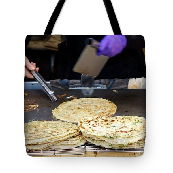 Tote Bag featuring the photograph Chinese Street Vendor Cooks Onion Pancakes by Yali Shi