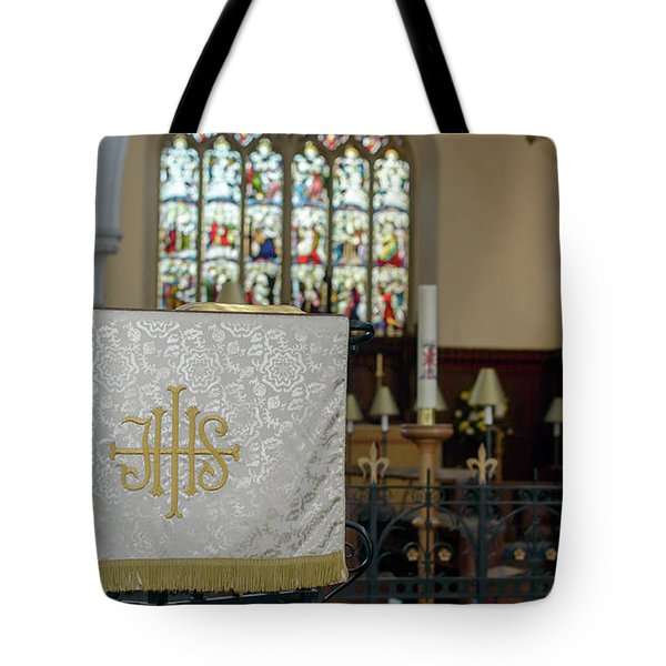 Tote Bag featuring the photograph Christogram Ihs On Pulpit Cloth In Gothic English Church by Jacek Wojnarowski