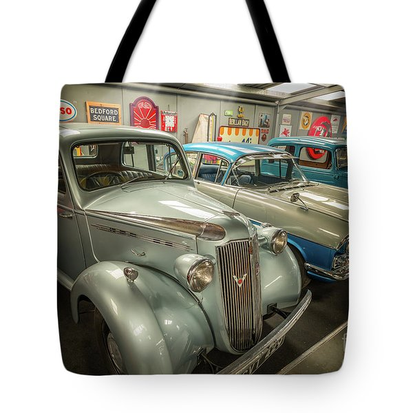 Tote Bag featuring the photograph Classic Car Memorabilia by Adrian Evans