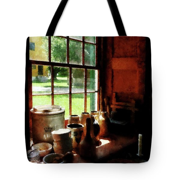 Tote Bag featuring the photograph Clay Jars On Windowsill by Susan Savad