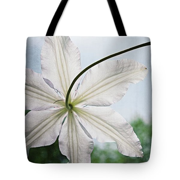 Tote Bag featuring the photograph Clematis Vine And Leaves by Michelle Calkins