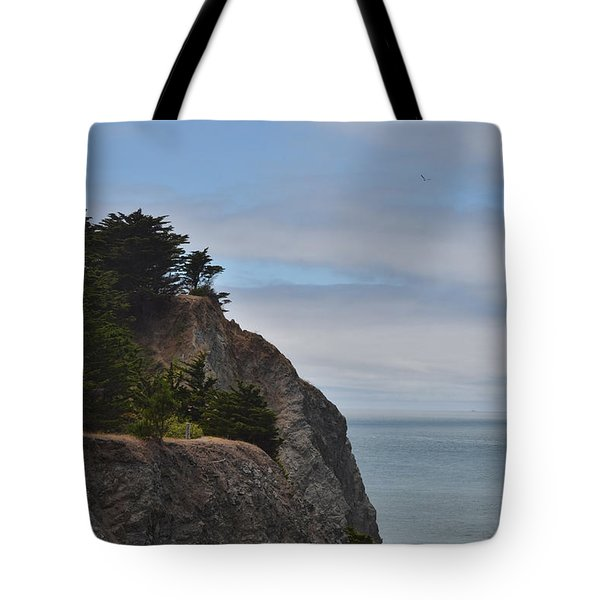 Tote Bag featuring the photograph Cliff Hanger by Judy Wolinsky