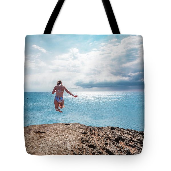 Tote Bag featuring the photograph Cliff Jumping by Break The Silhouette