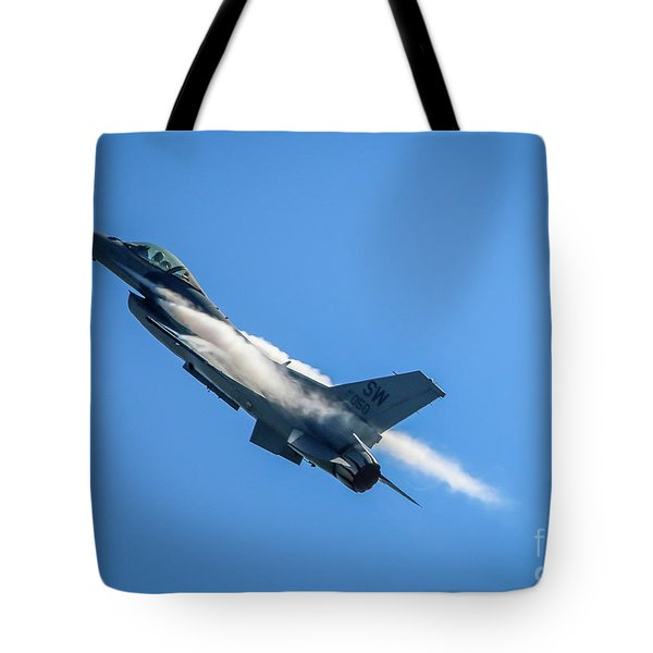 Tote Bag featuring the photograph Climbing Falcon by Tom Claud