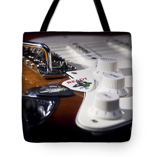 Tote Bag featuring the photograph Close Up Guitar by MGL Meiklejohn Graphics Licensing