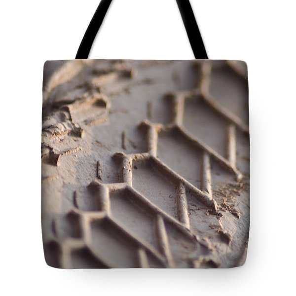 Close Up Of Motorcycle Tread Pattern On Muddy Trail Tote Bag by Jason Rosette