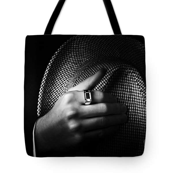 Close-up Shot Of A Male Ring Hand Holding Hat Tote Bag