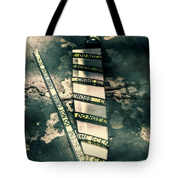 Closeup Of Knife Wrapped With Do Not Cross Tape On Floor Tote Bag