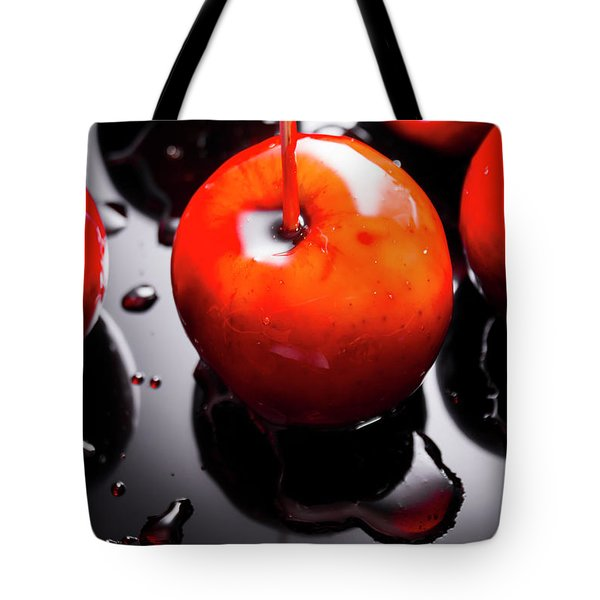 Closeup Of Red Candy Apple On Stick Tote Bag