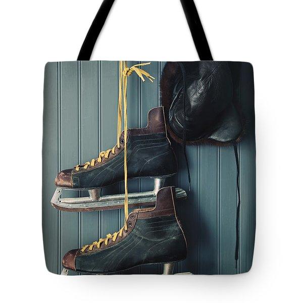 Closeup Of Vintage Men's Skates And Hat On Hooks Tote Bag
