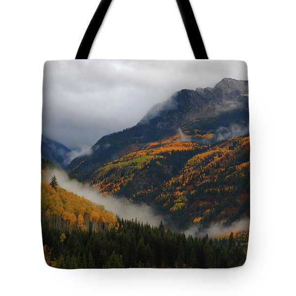 Tote Bag featuring the photograph Clouds And Fog Encompass Autumn At Mcclure Pass In Colorado by Jetson Nguyen
