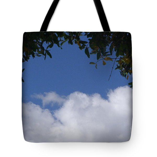 Clouds Framed By Tree Tote Bag by Nora Boghossian