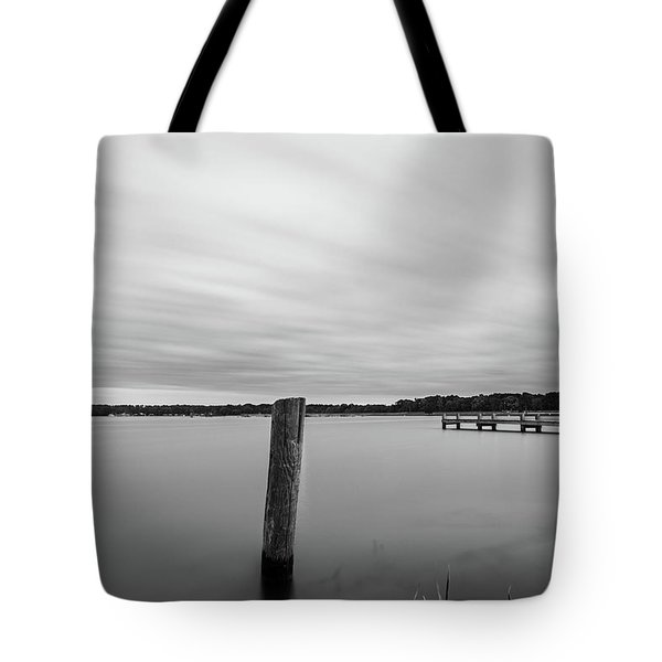 Tote Bag featuring the photograph Clouds Moving Over Lake Long Exposure by Todd Aaron