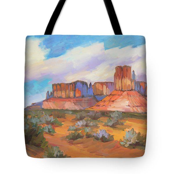 Tote Bag featuring the painting Clouds Passing Monument Valley by Diane McClary