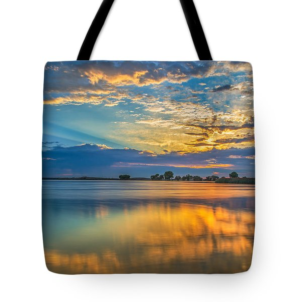 Clouds Reflected At Sunrise Tote Bag by Marc Crumpler