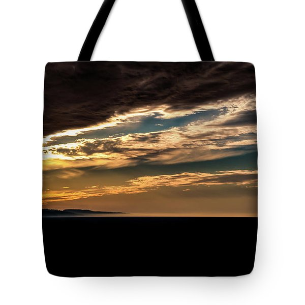 Tote Bag featuring the photograph Cloudy Sunset by Onyonet  Photo Studios