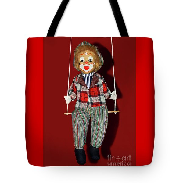 Tote Bag featuring the photograph Clown On Swing By Kaye Menner by Kaye Menner