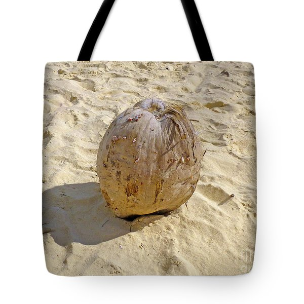 Tote Bag featuring the photograph Coconut In The Sand by Francesca Mackenney