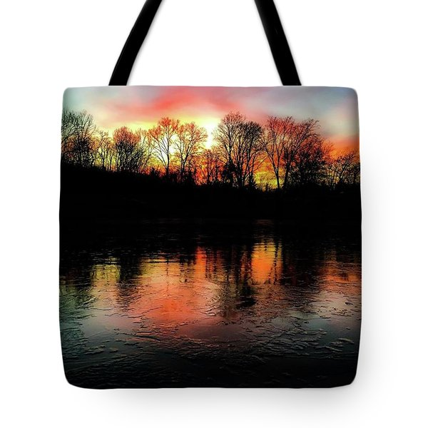 A Frozen Lake Relect The Bold Setting Sun Colors  Tote Bag