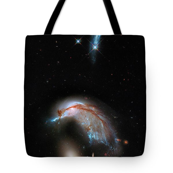 Tote Bag featuring the photograph Colliding Galaxy by Marco Oliveira