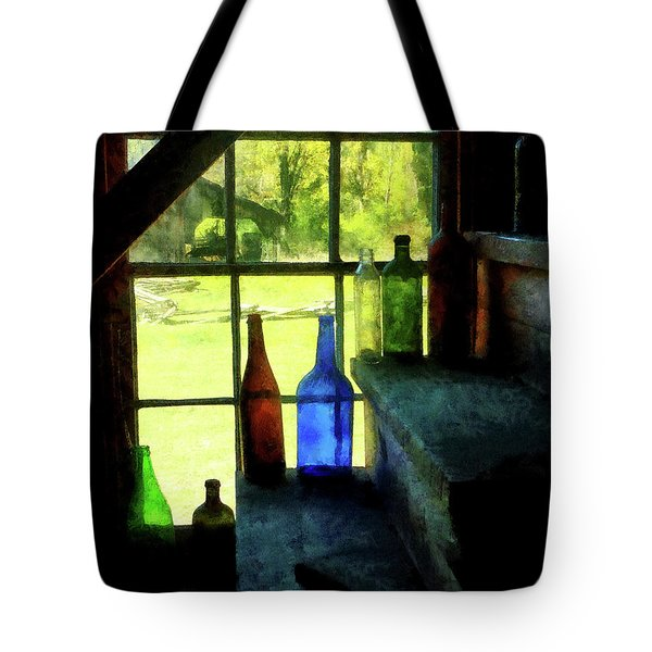 Tote Bag featuring the photograph Colored Bottles On Steps by Susan Savad