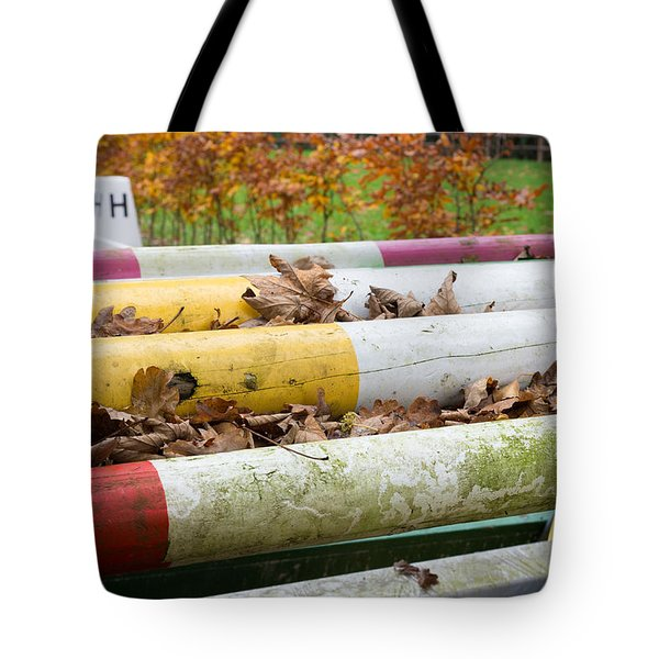 Tote Bag featuring the photograph Colorful Poles by Hans Engbers