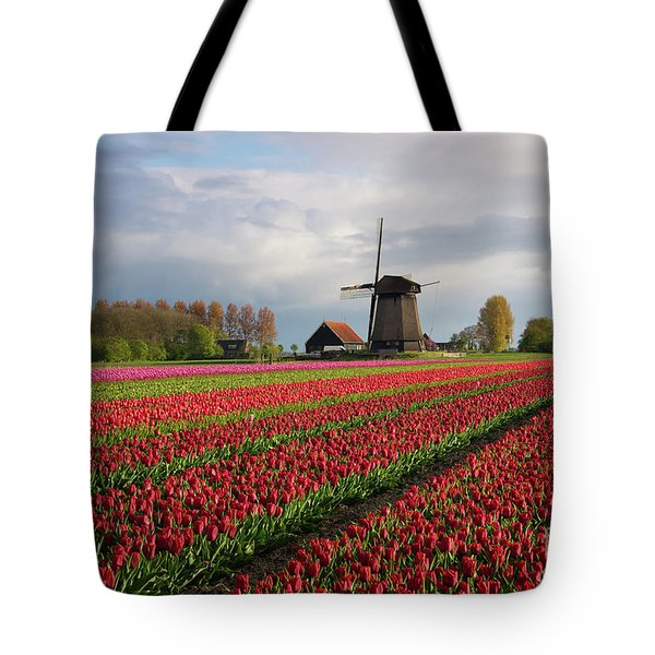 Tote Bag featuring the photograph Colorful Rows Of Tulips In Front Of A Windmill by IPics Photography