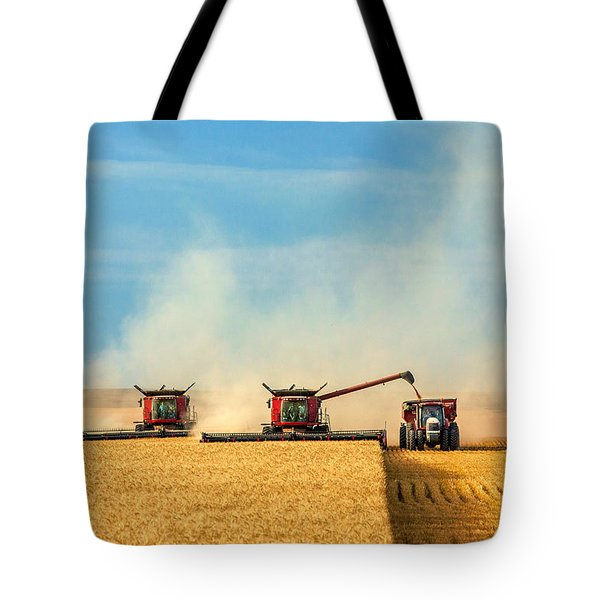 Tote Bag featuring the photograph Combines And Tractor Working Together by Todd Klassy
