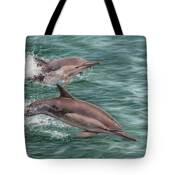 Common Dolphins Tote Bag by David Stribbling