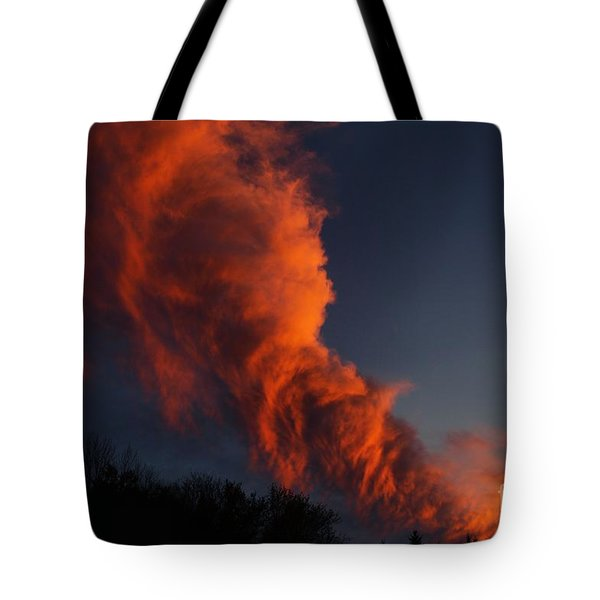 Tote Bag featuring the photograph Contorted Clouds by Kenny Glotfelty