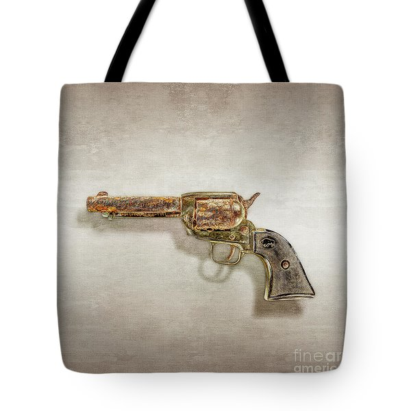 Tote Bag featuring the photograph Corroded Peacemaker by YoPedro