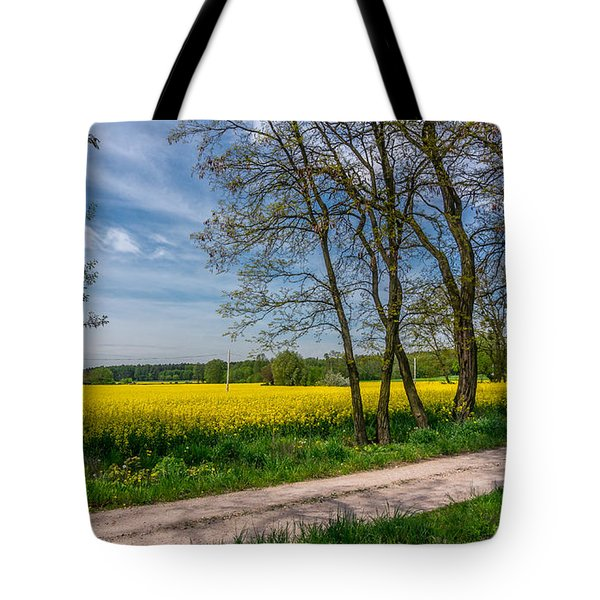 Tote Bag featuring the photograph Country Road In The Rapeseed Field by Dmytro Korol