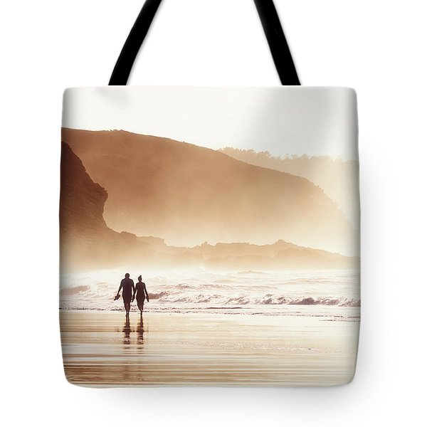 Couple Walking On Beach With Fog Tote Bag