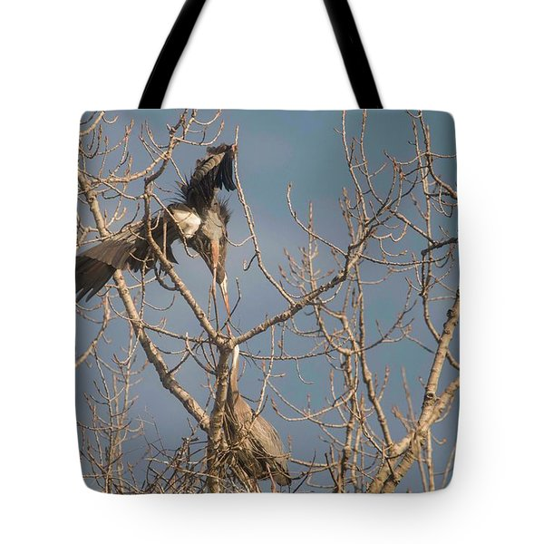 Tote Bag featuring the photograph Courtship Ritual Of The Great Blue Heron by David Bearden
