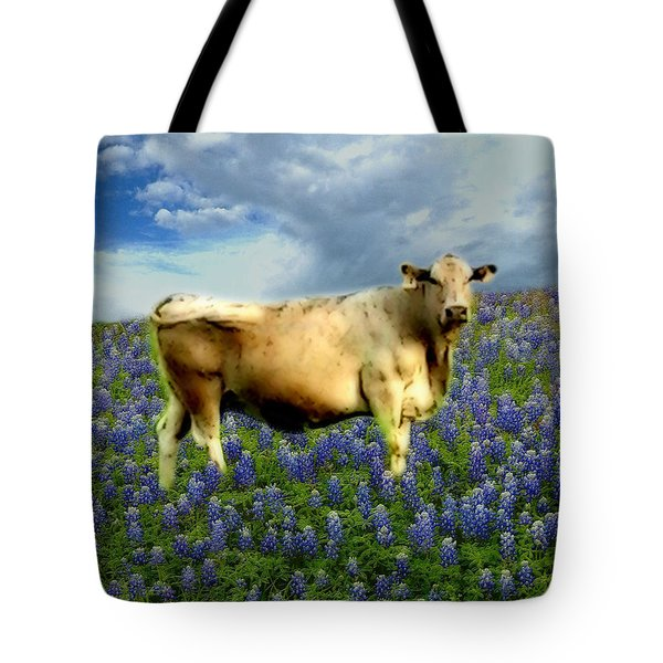 Tote Bag featuring the photograph Cow And Bluebonnets by Barbara Tristan