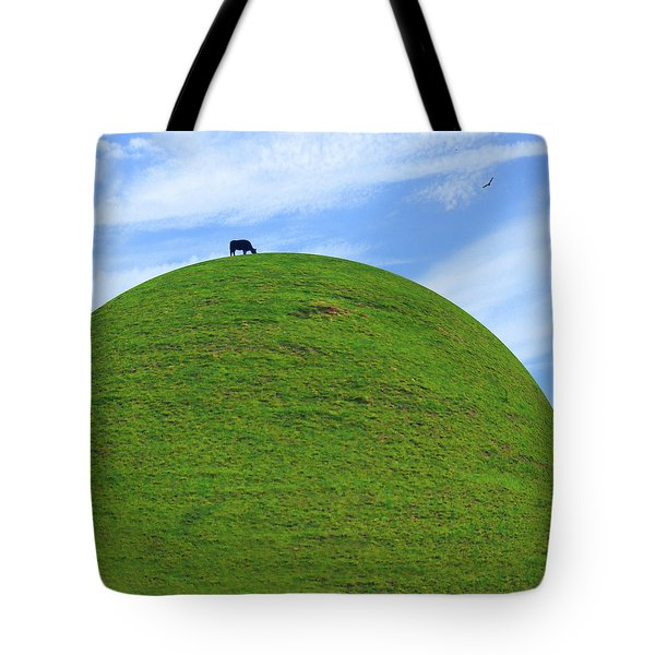 Cow Eating On Round Top Hill Tote Bag by Mike McGlothlen
