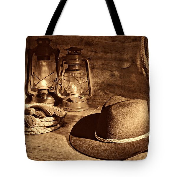 Cowboy Hat And Kerosene Lanterns Tote Bag by American West Legend By Olivier Le Queinec
