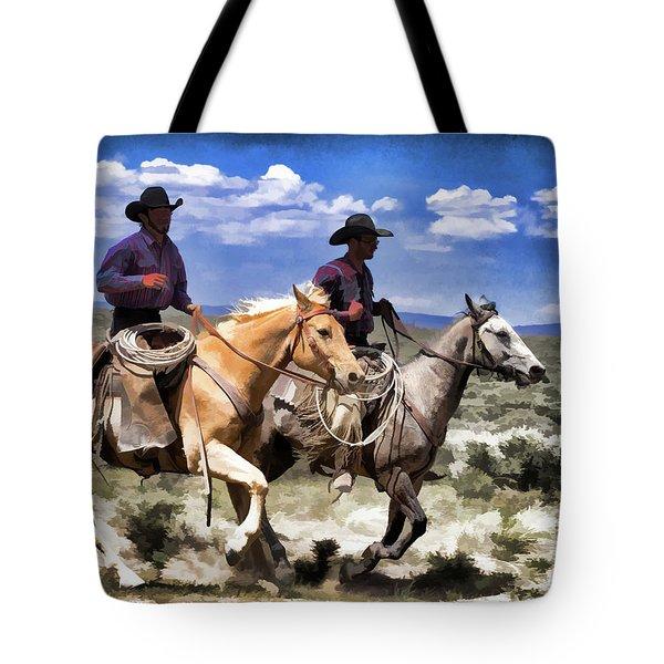 Tote Bag featuring the digital art Cowboys On Horseback Riding The Range by Nadja Rider