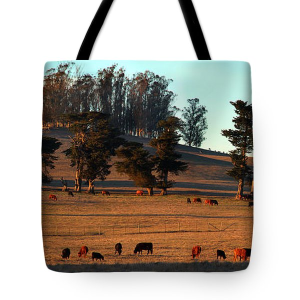 Cows Grazing Into The Sunset In Marin County California Tote Bag by Wernher Krutein