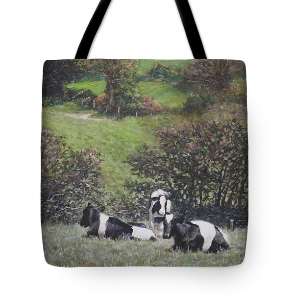 Tote Bag featuring the painting Cows Sitting By Hill Relaxing by Martin Davey