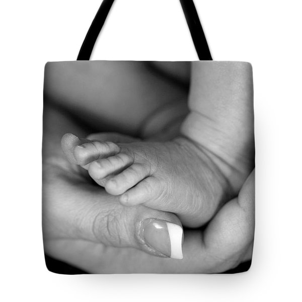 Tote Bag featuring the photograph Cradled by Angela Rath