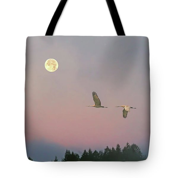 Tote Bag featuring the photograph Cranes And A Full Moon At Dawn by Peggy Collins