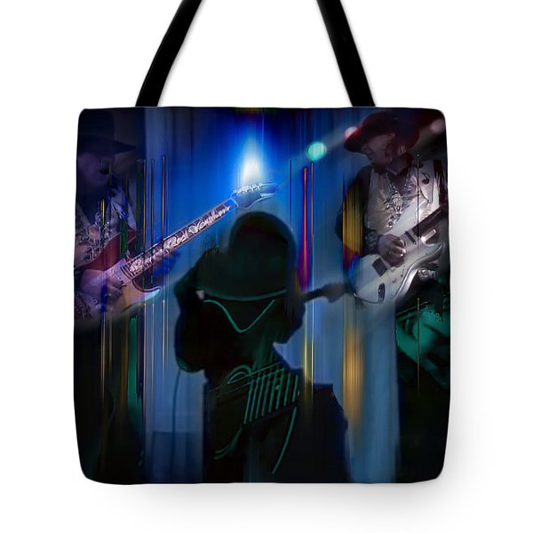Tote Bag featuring the photograph Crossfire by Glenn Feron