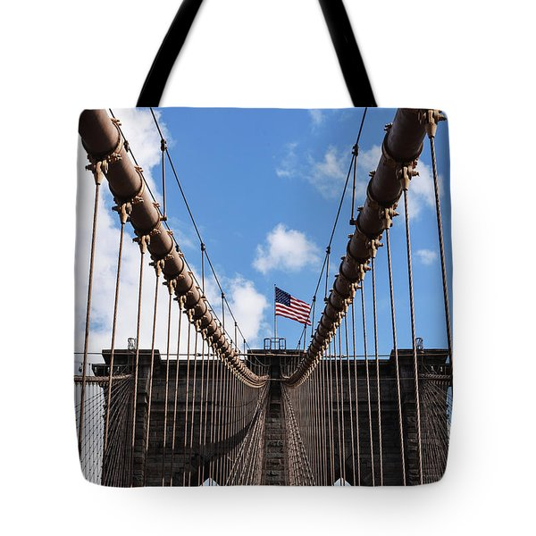 Tote Bag featuring the photograph Crossing The Brooklyn Bridge by Judy Wolinsky