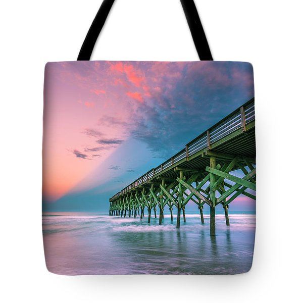 Tote Bag featuring the photograph Crystal Beach Pier Sunset In North Carolina by Ranjay Mitra