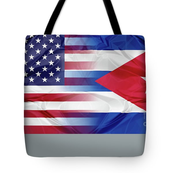 Tote Bag featuring the photograph Cuba And Usa Flags by Benny Marty